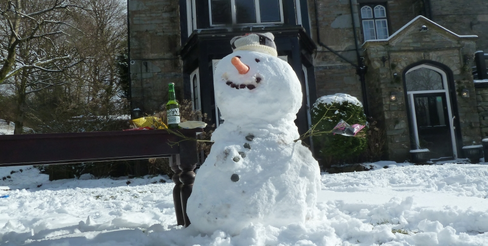 Our snowman is very jolly!